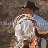 Cowboy Prepares to Rope Calf