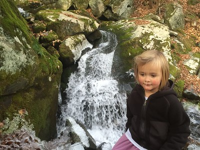 C and her back drop. The waterfall on the brook on the ouzel, one of our favorite spots.