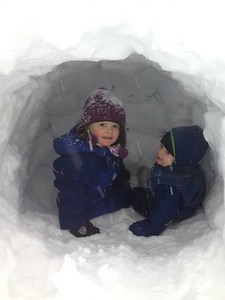 C and G in snow cave on in a snow bank.