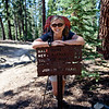 Karen and one of the signs along the John Muir Trail. The Sierra Nevada Mountains in California, United States.