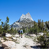 Cathedral Peak and hikers on the John Muir Trail, the Sierra Nevada Mountains in California, United States.