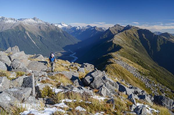 Joe approaching the summit of Mount Watney after hours of gruelling terrain.