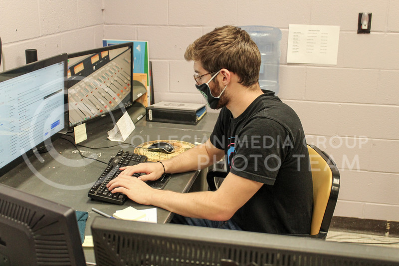 Working in his office, sophomore in Political Science and Pre-Law Trey Kulhmann and News Director of Wildcat 91.9 radio station sends emails.<br /> Photo by Macey Franko