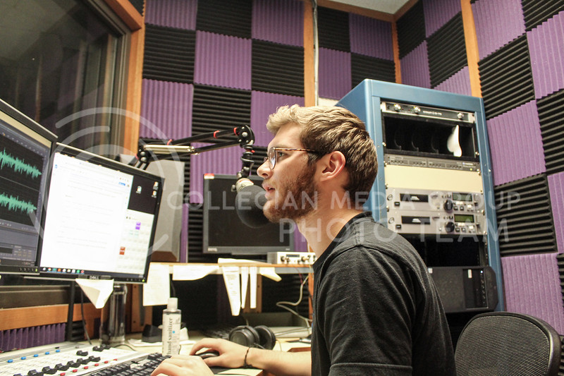 Working in the recording studio, sophomore in Political Science and Pre-Law Trey Kulhmann tests recordings.<br /> Photo by Macey Franko