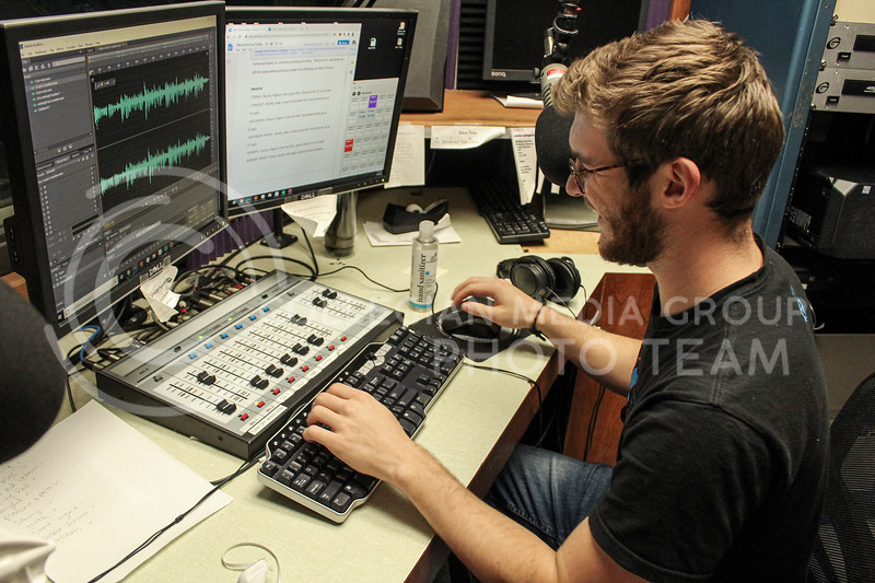 Typing, sophomore in Political Science and Pre-Law Trey Kulhmann edits tracks for Wildcat 91.9 as the News Director.<br /> Photo by Macey Franko