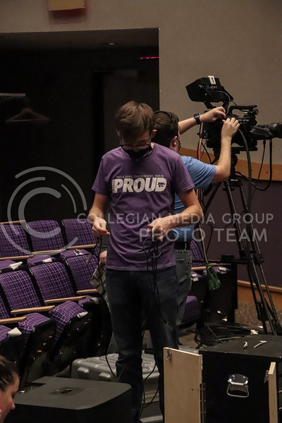 Looking down, Wildcat Watch member sorts out wires  for the cameras at an event in Forum Hall in the Union on November 15 being recorded by Wildcat Watch.<br /> Photo by Macey Franko