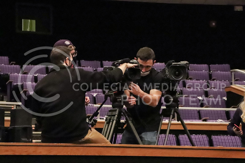 Adjusting the video camera, Daniel Lopez, senior in Mechanical Engineering, makes sure all of the settings are right before the event being recorded by Wildcat Watch on November 15 in Forum Hall.<br /> Photo by Macey Franko