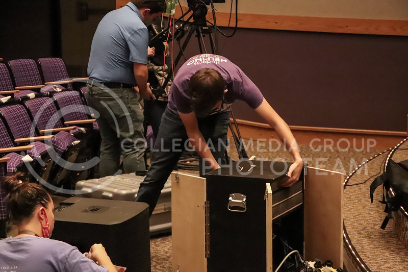 Working with a sound box, Wildcat Watch member connects cords before an event on November 15. <br /> Photo by Macey Franko