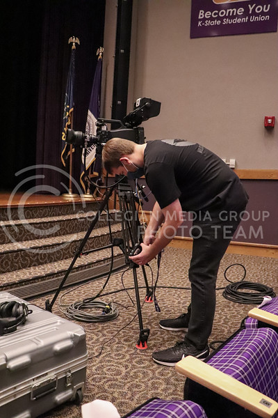 Plugging in wires, junior in Political Science Connor Balthazor sets up equipment before an event being recorded by Wildcat Watch on November 15.<br /> Photo by Macey Franko