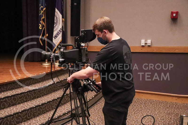 Connor Balthazor, junior in Political Science, sets up his camera in Forum Hall before an event being recorded by Wildcat Watch on November 15.<br /> Photo by Macey Franko