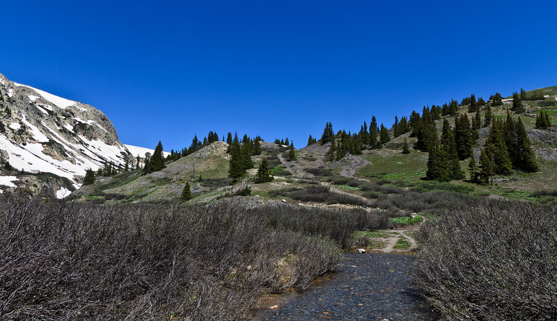 The trail led over the hill and on to Hunchback Pass. The snowy ridge to the left was an ominous sign...