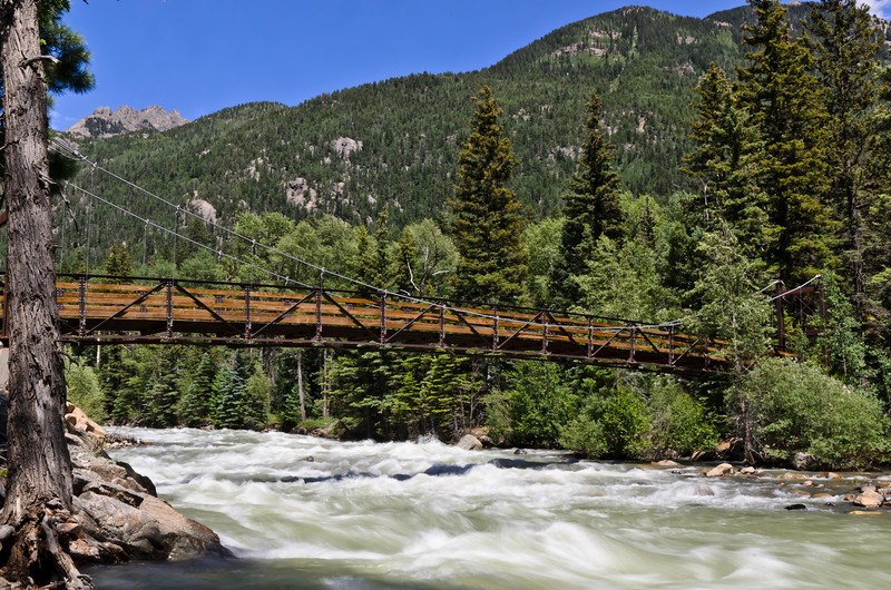 The bridge over the Animas river. I made several attempts at capturing this image and this one turned out to be my favorite. This bridge leads to epic adventure!