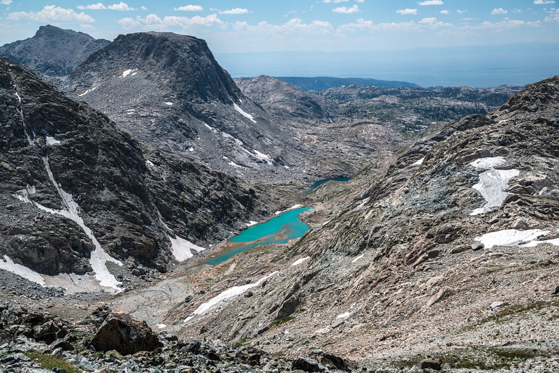 While walking back down from the pass, we paused to capture this amazing view of Indian Basin. We never found the time to walk down to this lake as it was several hundred feet below our camp. The brilliant aqua coloration was a stark contrast to the greys and browns of the high alpine terrain.