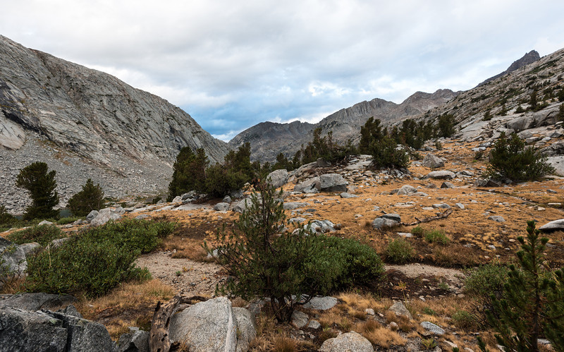 Next morning it was off to climb Mather Pass. I'd say when you include the Golden Staircase, Mather Pass was the most difficult of all the passes I crossed. The view in this image is looking back north. Our campsites were in the trees center picture.