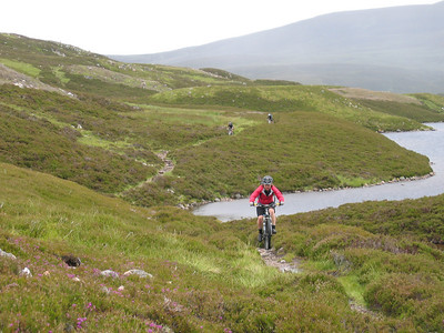 The reward for the climb to Loch Builg is 3km of classic Cairngorms singletrack.