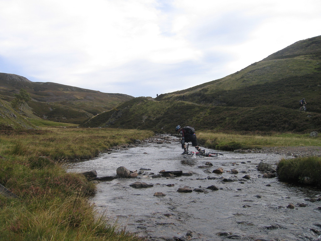 Day 2 - Numerous river crossings provided great entertainment. Steve leads the way into Glen Avon (minus the bike).