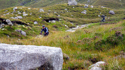 A superb switch-back descent takes us from the pass to the river crossing.