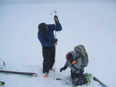 Probing during avalanche rescue practice.