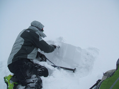 Looking at the layers in the snow pack.
