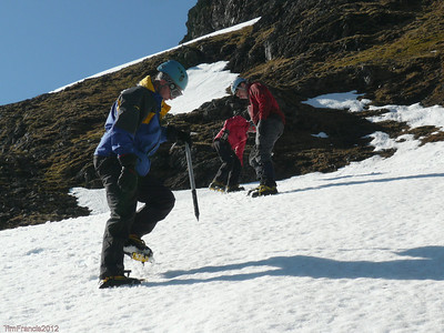 Getting to grips with spikes, winter skills, Creag Meagaidh NNR.
