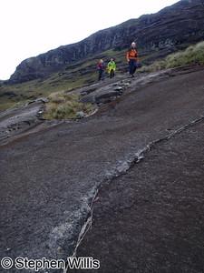 Easy walking across wonderfully grippy gabbro rock