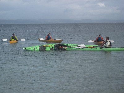 The guides taking it in turn to get wet doing some drills on the final paddle