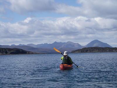 Crossing to Crowlin Islands with Skye Cuillin in the background