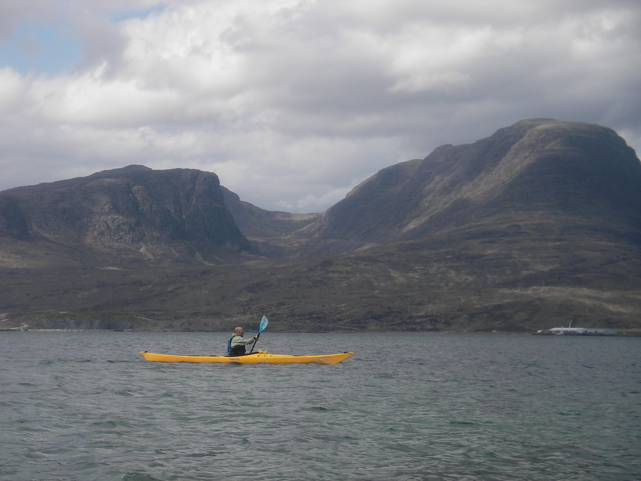 Day 5.  Ritchie on Loch Kishorn.  Bealach Na Ba in the background.