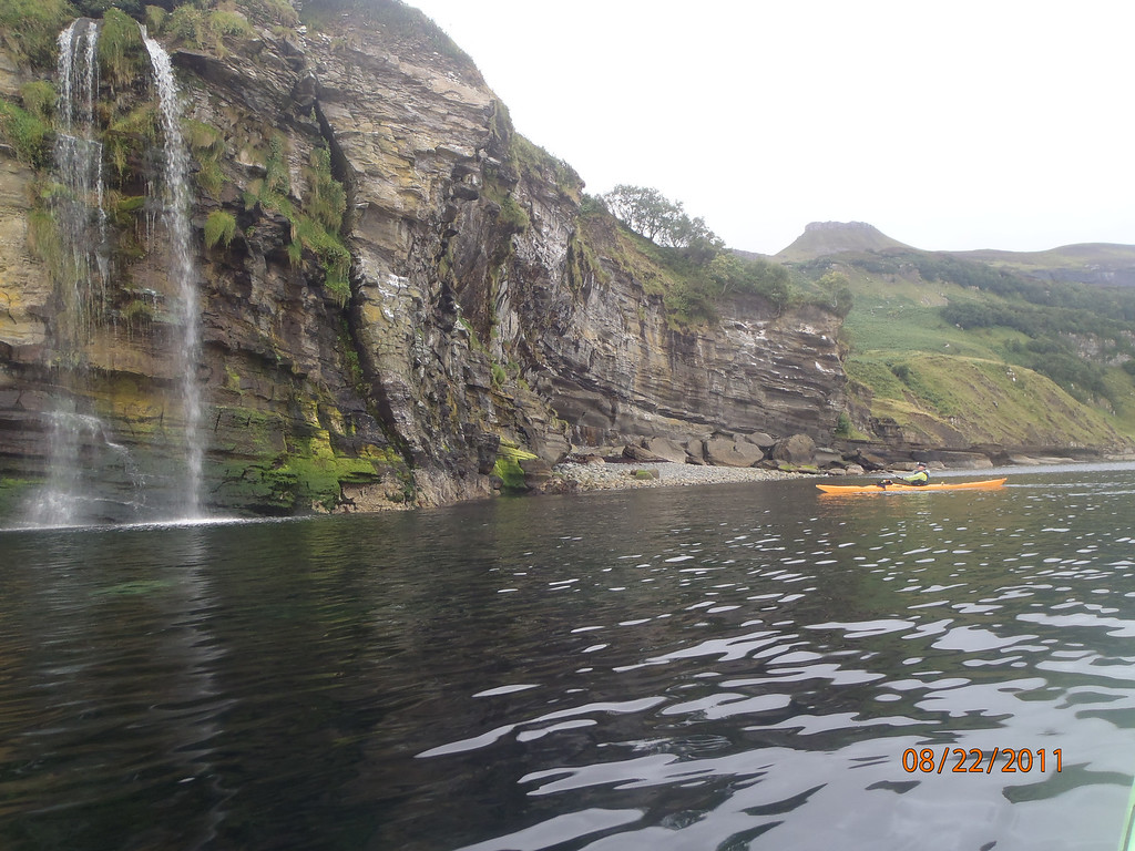 Hallaig power shower with Dun Cann in the back ground