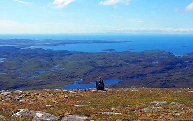 Mike on the summit of Suilven, looking toward the Summer Isles.