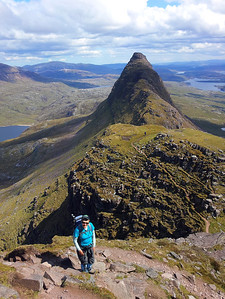 Glynis approaching the summit of Suilven, looking toward the east summit.