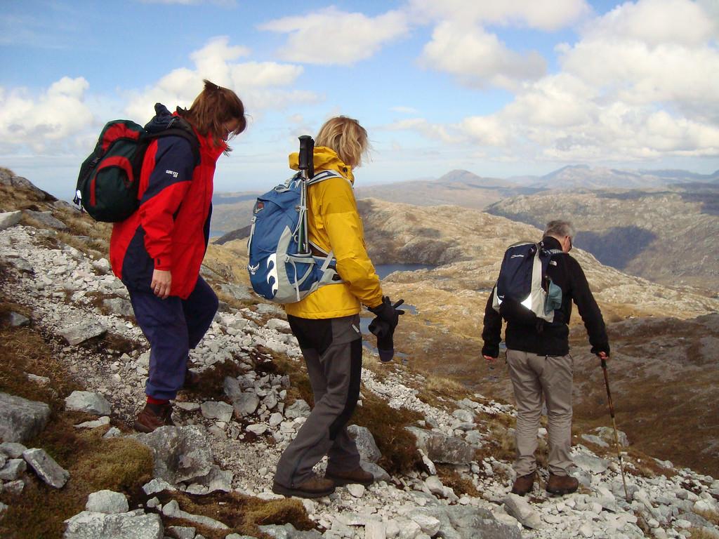 Amanda, Caroline and John descend challenging slopes on Glas-bheinn