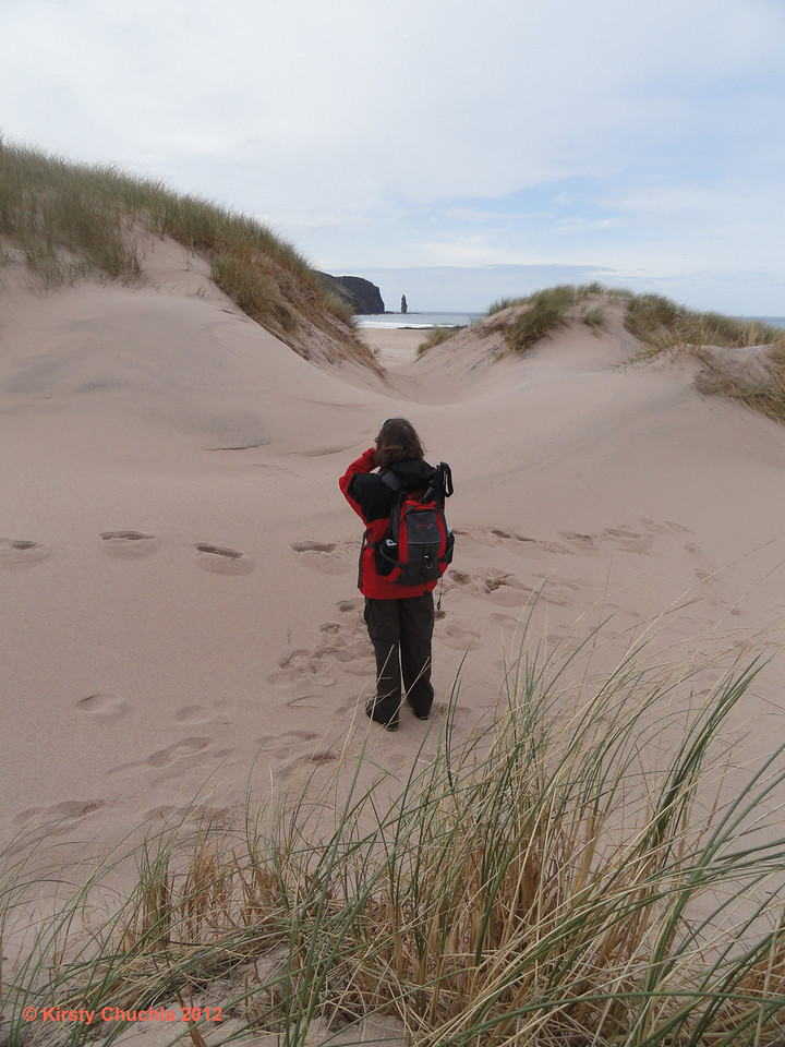 The first glimpse of Am Buachaille through the sand dunes of Sandwood Bay