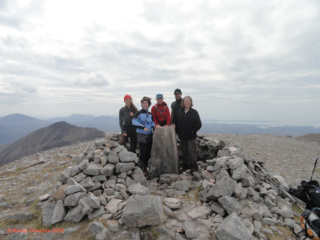 The team enjoying the clear views from the summit of Quinag - Sail Gharbh (The Rough Heel) 809m
