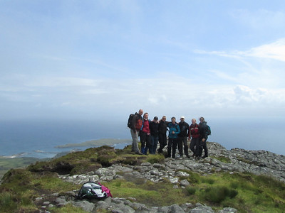 whole Group on top Of the Sgur Eigg with clear blue skies and the mainland in the back ground