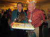 Eve Nipp baked some wonderful wilderness birthday cakes.  She has Joe Fontaine blow out the candles.