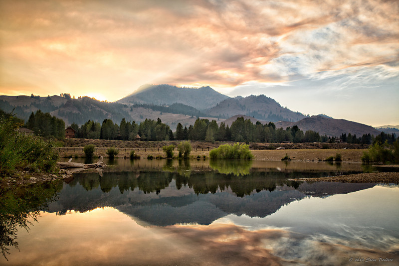 While some of this smoke was coming from the Beaver Creek Fire, the majority of it was coming from the Kelley Creek fire, also west of Sun Valley.  It snowed ash for a number of hours this day.  Photo take from the Hulen Meadows pond at sunset, August 30, 2013, looking west.