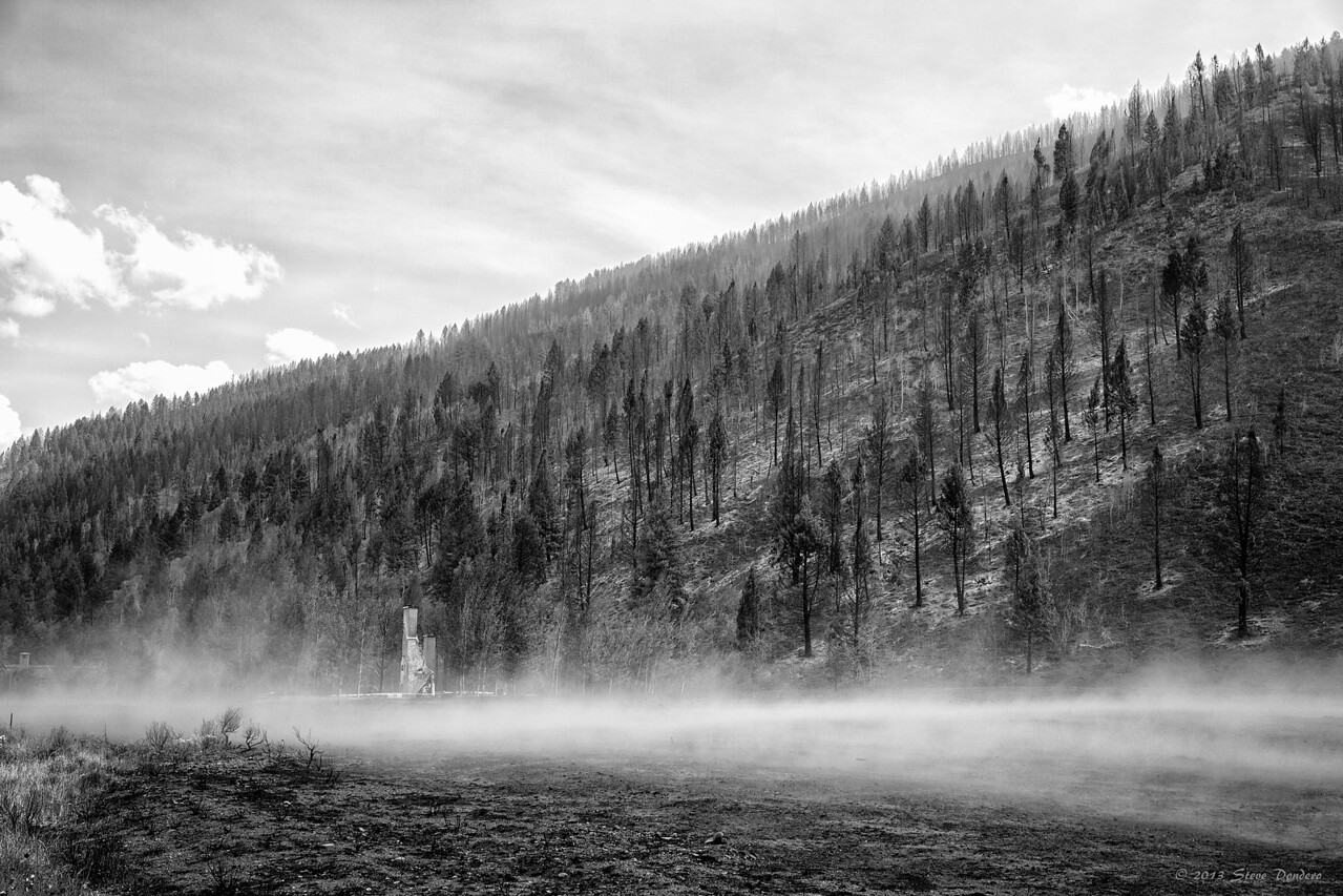 Blowing ash passes through where this house once stood.  Greenhorn Gulch.  August 25, 2013
