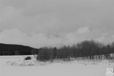 Sarah Ernst - Mt Moran in Snowy Clouds