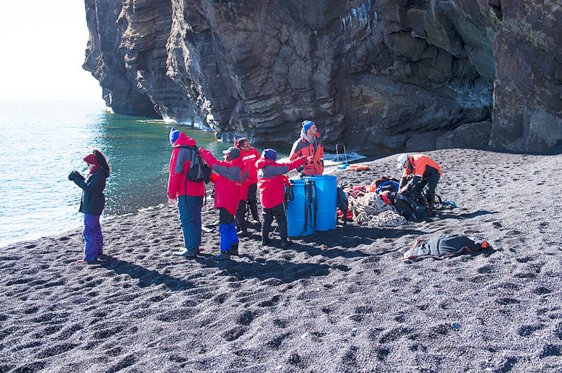 On the beach at Baily Head, a prominent headland forming the easternmost extremity of Deception Island preparing to hike inland (Blue barrels hold life jackets)