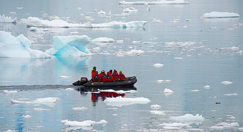 Cruising in a zodiac in Neko Harbor, an inlet on the Antarctic Peninsula on Andvord Bay, situated on the west coast of Graham Land.