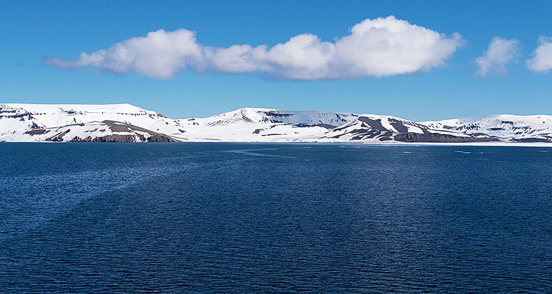 Port Foster, a harbor in the center of Deception Island, created from a volcanic calder, flooded by the sea, the entrance of which is Neptune's Bellows, a channel on the southeast side of Deception Island, with Stonethrow Ridge and Primero de Mayo Bay straight ahead.