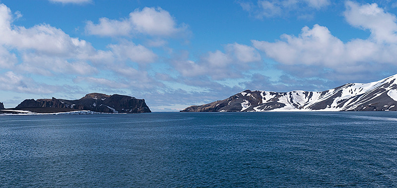 Port Foster, a harbor in the center of Deception Island, created from a volcanic calder, flooded by the sea, the entrance of which is Neptune's Bellows, a channel on the southeast side of Deception Island, seen in the center, in the background