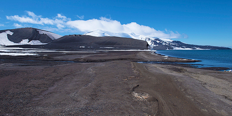 Looking down the beach at Telefon Bay, a small bay in the northwest side of Port Foster, Deception Island, in the South Shetland Islands, surmounted by Telefon Ridge, toward Goddard Hill.