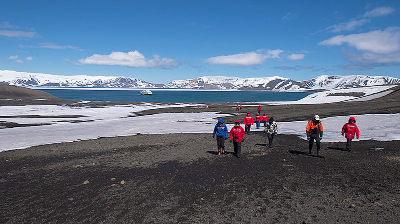 At Telefon Bay, a small bay in the northwest side of Port Foster, Deception Island, in the South Shetland Islands, hiking toward Telefon Ridge
