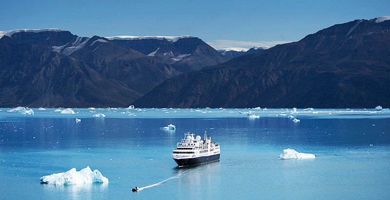 Zodiac for Silver Explorer and Silver Explorer in Rodefjord, Renodde, Scoresby Sund, Greenland
