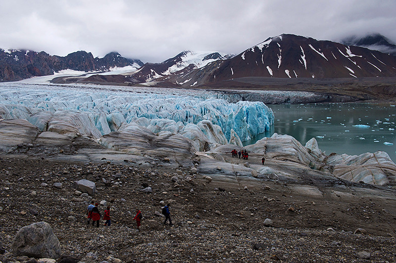 Climbing down to step on to the July 14th Glacier, Krossfjord, Svalbard