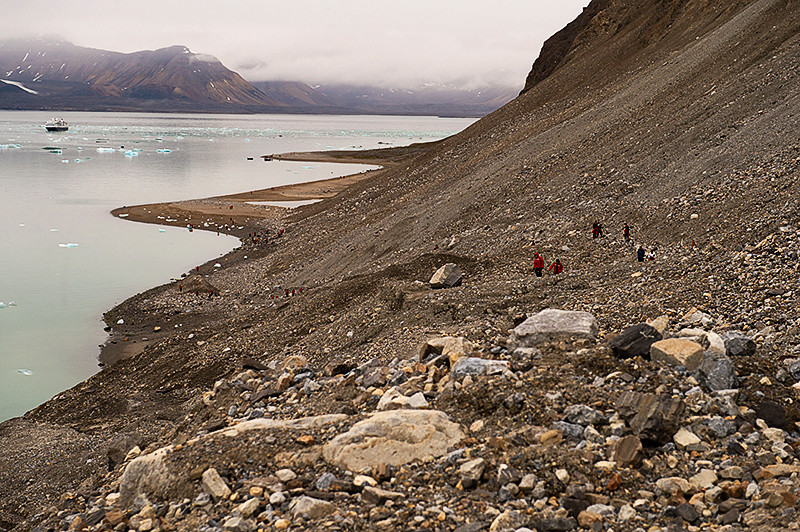 Climbing the mountain to the July 14th Glacier's top, Krossfjord, Svalbard