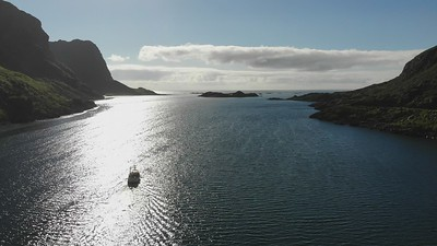 Fjord view to the ocean with fishing boat