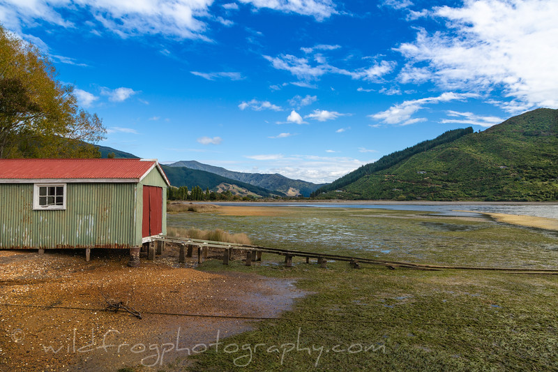 Boat shed at low tide